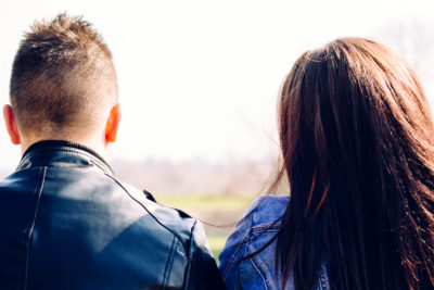 couple sitting together worried after sex