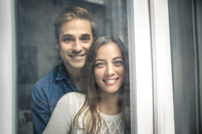 couple smiling worried about being pregnant