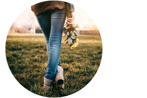 young woman standing with flowers considering abortion